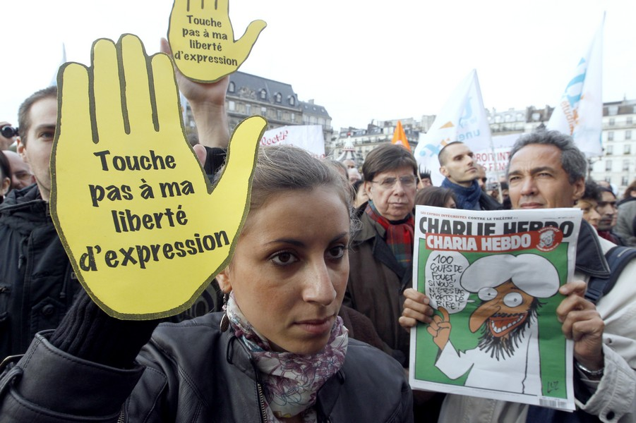People attend a support rally for French